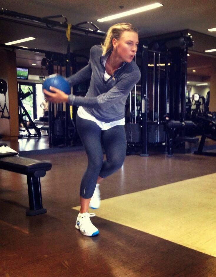 Maria Sharapova in the gym with a medicine ball