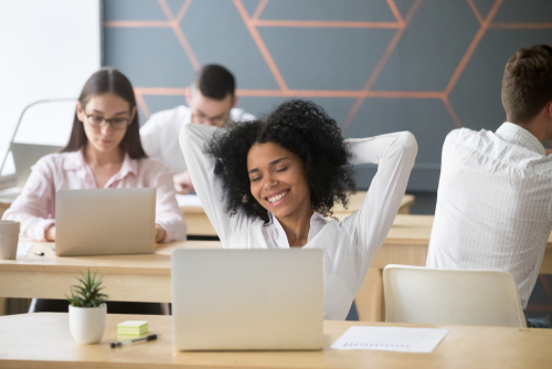 woman happy at work behind a computer