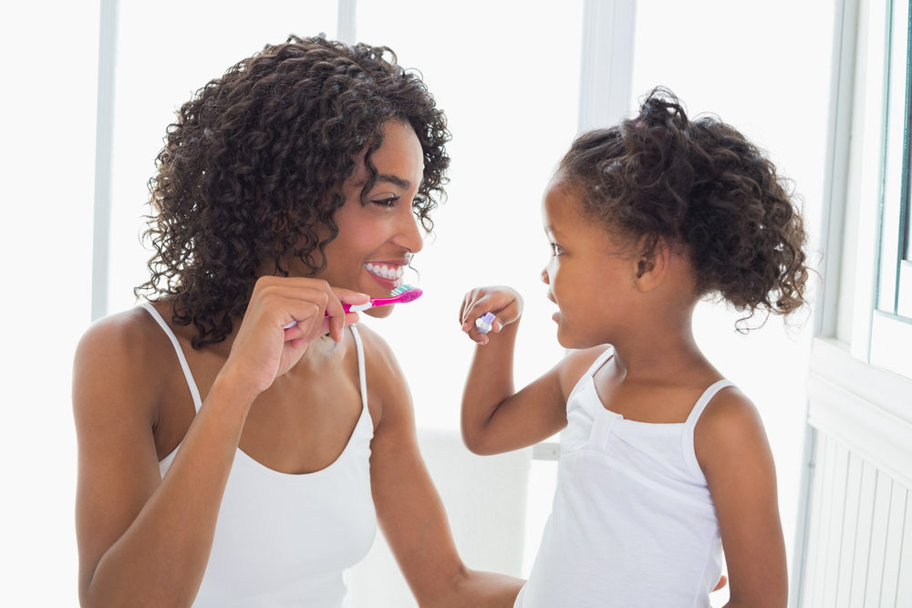 moher teaching her daughter to brush her teeth